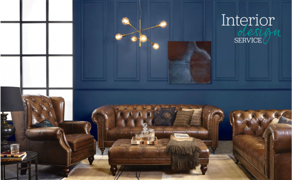 Brown leather chesterfield sofas in a dark blue room